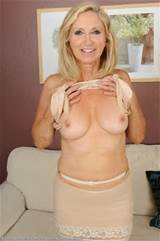Granny Annabelle takes her see-through pantyhose off nice and slow ...
