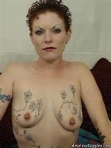 tattooed_milf_in_thighhighs_20.jpg