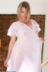 Blonde MILF in see through lingerie spreads her shaven pussy from All ...